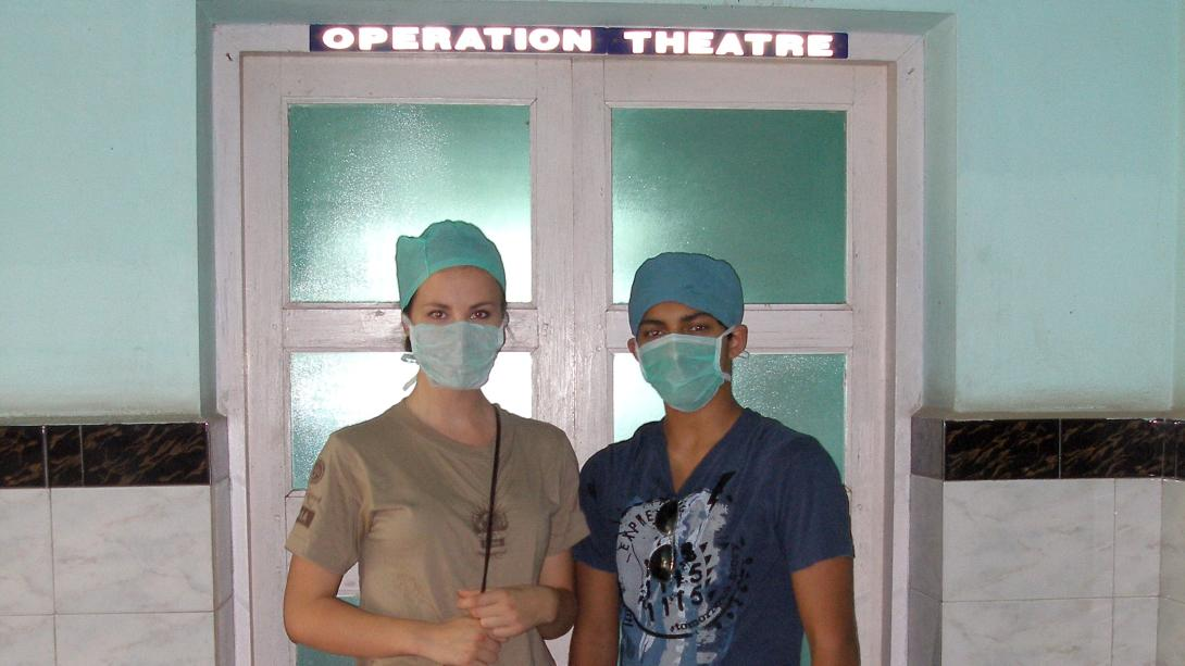 Medical interns stand outside the operating theatre in India.